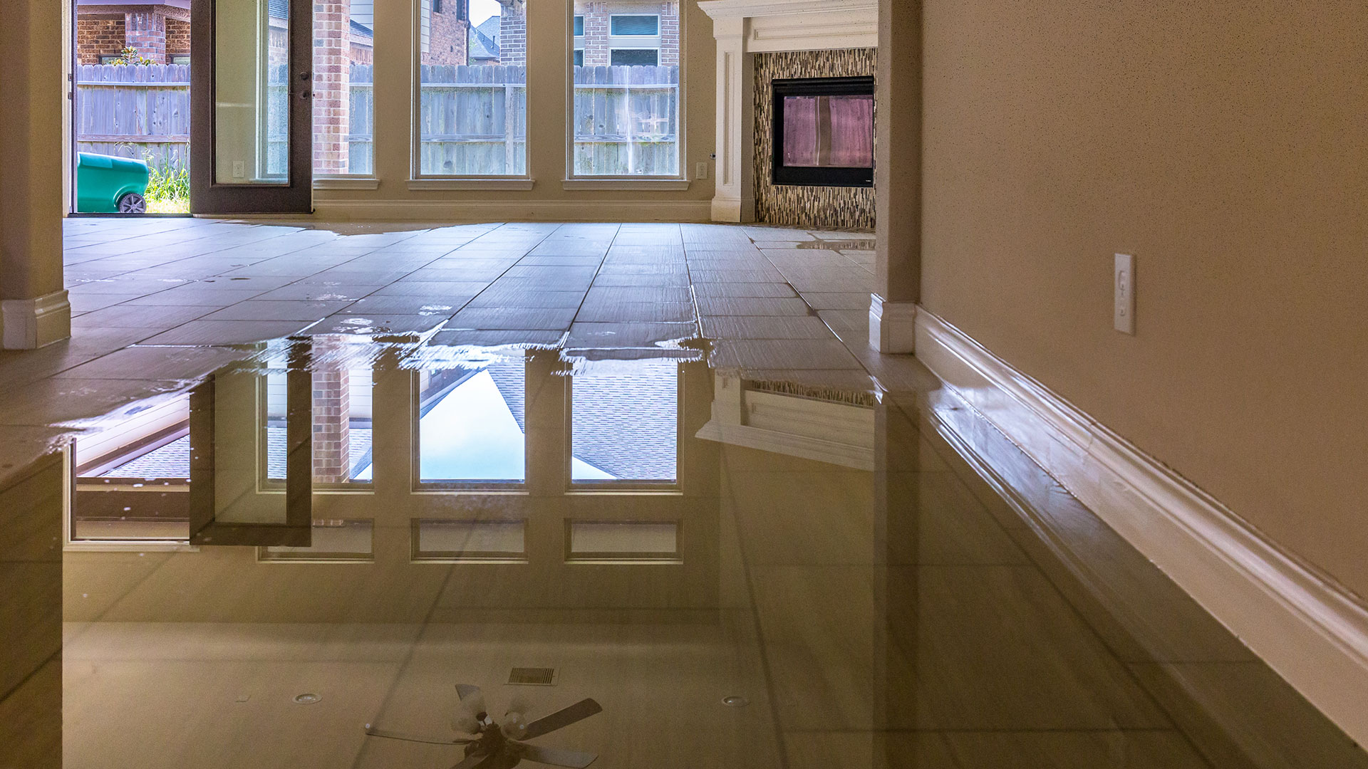 standing water over tile floor in home