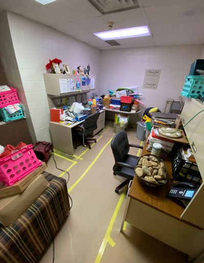 stacked furniture in office after tear out at Saint Stephens Church in Omaha, NE