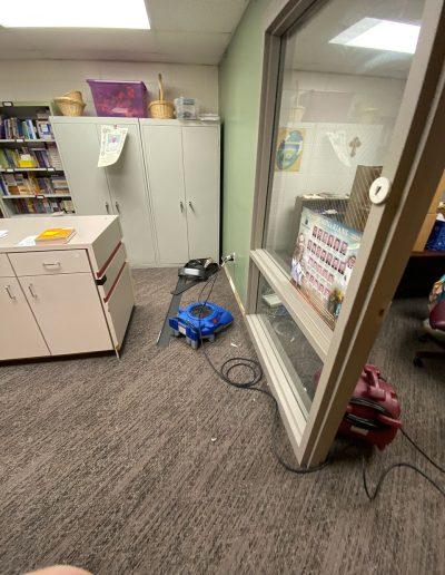 fans drying flooring in office at Saint Stephens Church in Omaha, NE