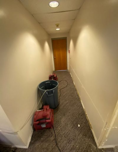 fans drying hallway during tear out at Saint Stephens Church in Omaha, NE