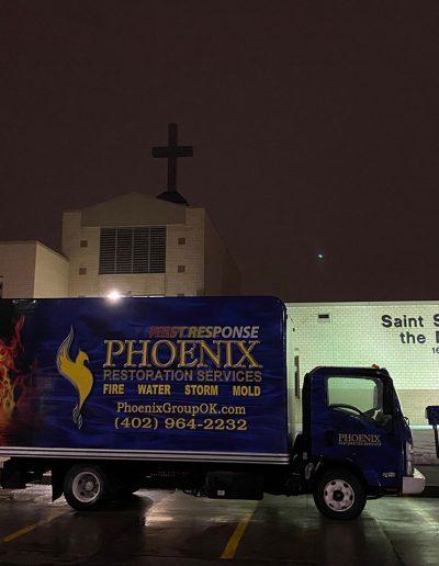 Phoenix Restoration truck outside Saint Stephens Church in Omaha, NE