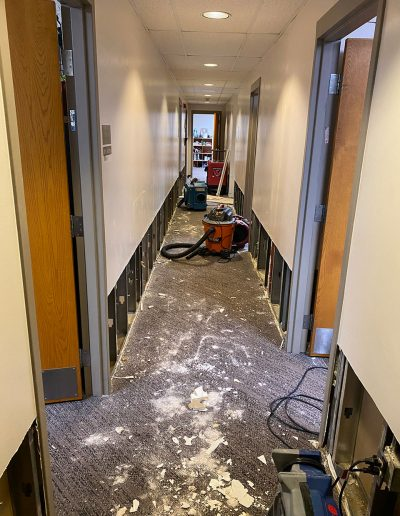 restoring lower walls in hallway at Saint Stephens Church in Omaha, NE