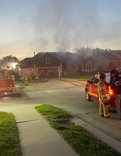 Phoenix Restoration truck and fire trucks on scene of house fire