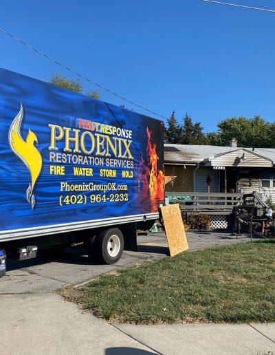 Phoenix Restoration truck on scene of house fire