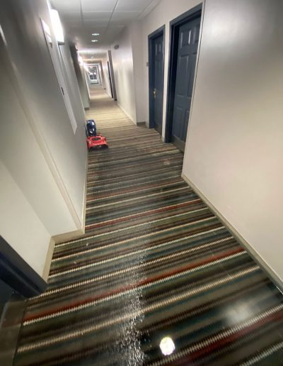 wet carpeted hallway in lobby of Country Inn & Suites