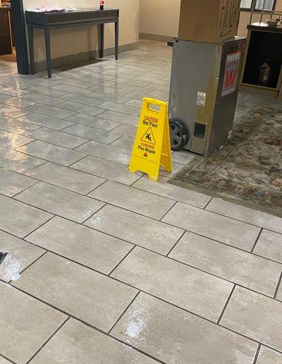 wet tile floor in lobby of Country Inn & Suites